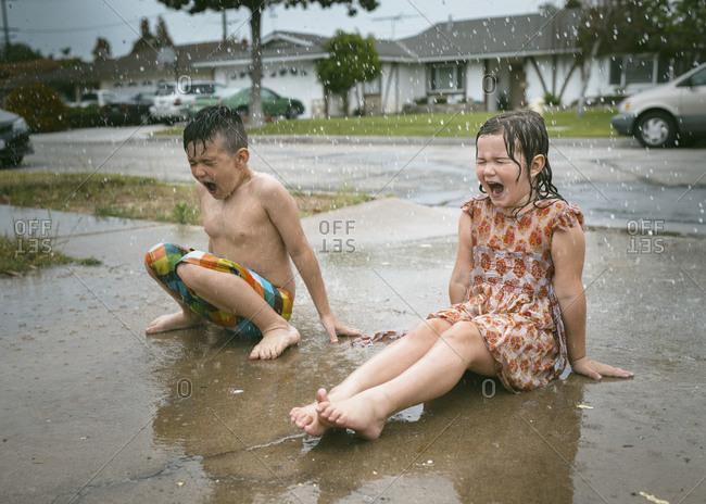 Children shouting in the rain