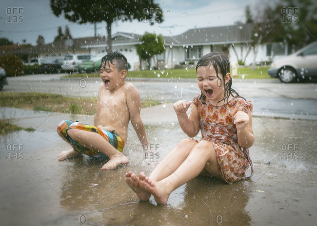 Girl with a boy shouting in the rain