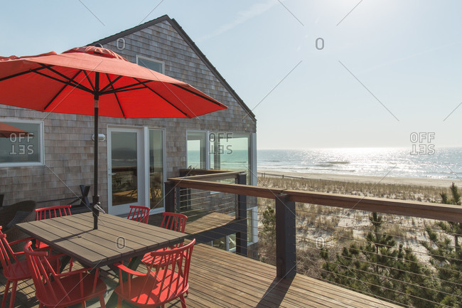 On the deck of an oceanfront beach cottage