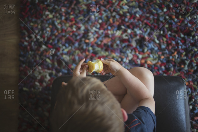 Overhead view of young boy holding an apple core
