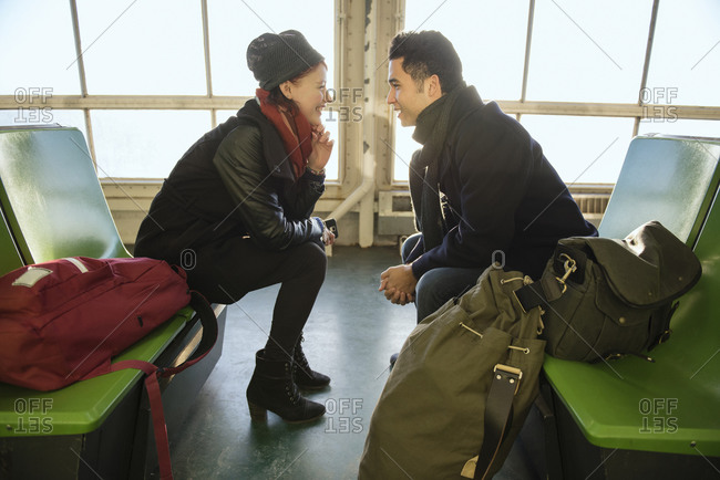 A couple chats while traveling on a ferry