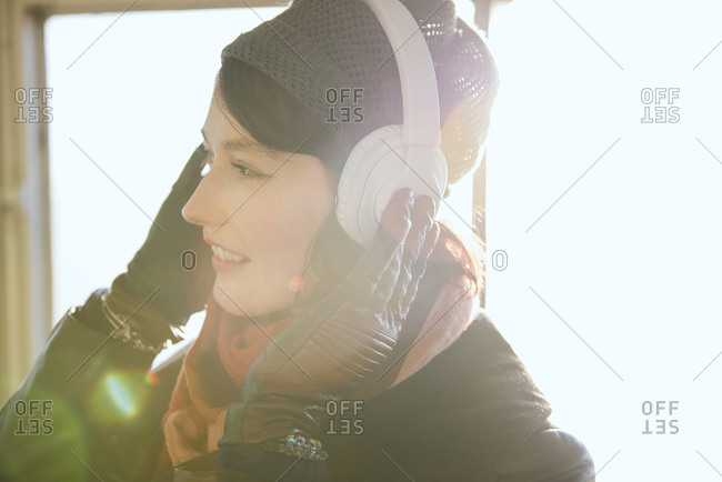 A woman listens to headphones on a ferry