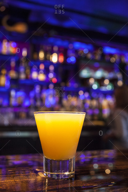 An orange gin cocktail at a bar