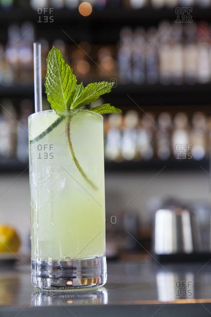 A mezcal cocktail on a bar