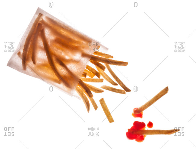 French fries in a bag with ketchup