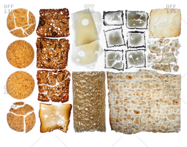 Crackers and cheese against a white background