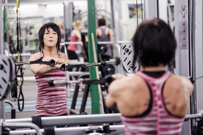 Confident female athlete exercising in health club