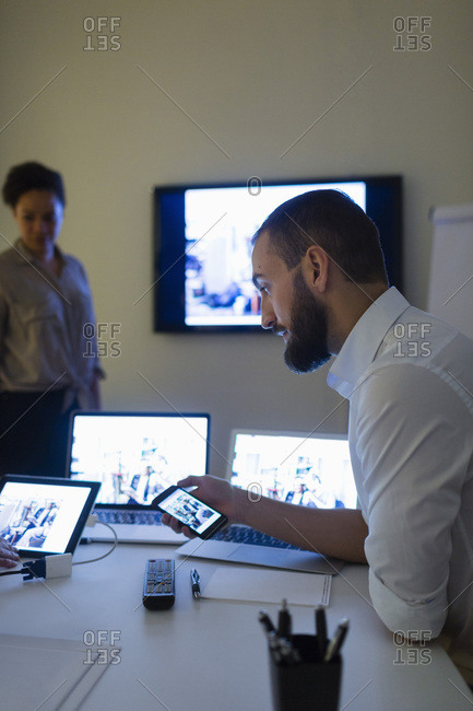 Businessman using technologies with colleagues in office