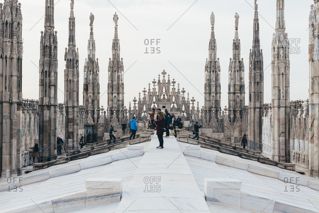 Milan, Italy - November 24, 2014: Tourists on the top of the Milan Cathedral