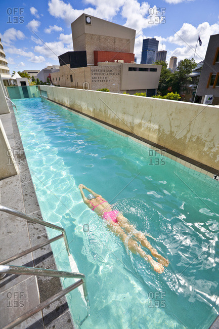 Brisbane, Australia - August 30, 2008: A woman swimming in a city lap pool, Brisbane, Queensland, Australia