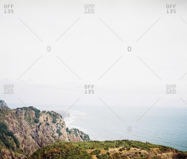 Cliffs on a misty seacoast