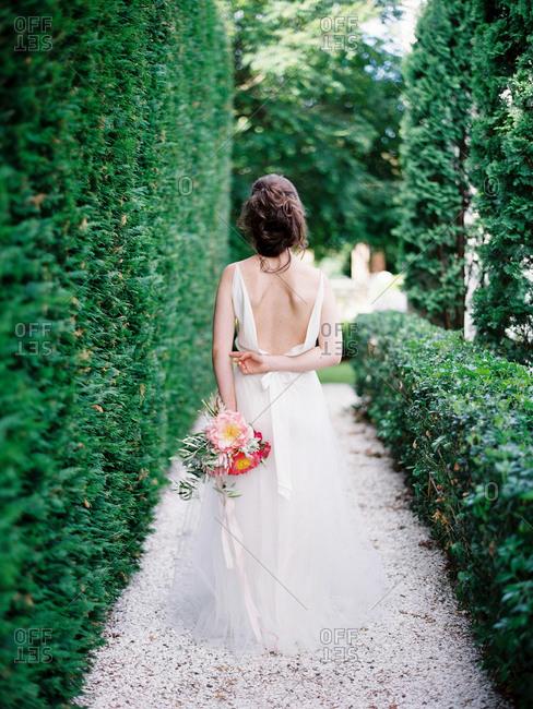 Bride walking in a garden