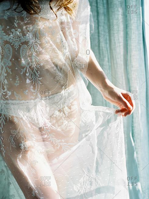Woman wearing a lace dress