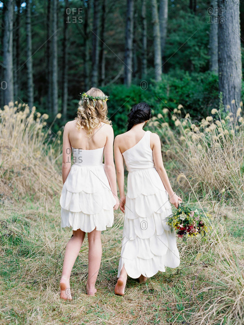 Bridesmaids walking in a forest
