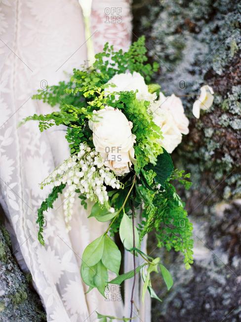 Bride holding a stylish flower bouquet