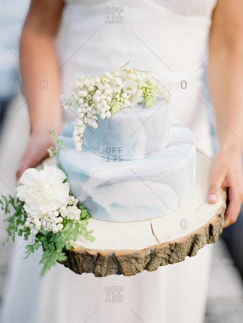 Bride serving a wedding cake