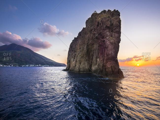 Isola Strombolicchio with lighthouse at sunset, Aeolian Islands