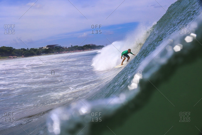 Surfer in the tube getting barreled, Bali