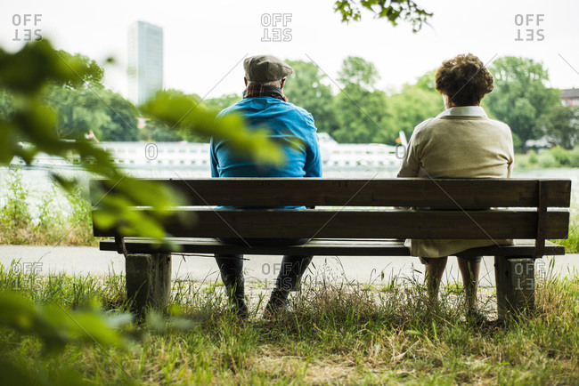 Back view of senior couple sitting on a bench