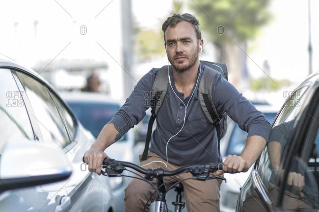 Man on bicycle in traffic jam