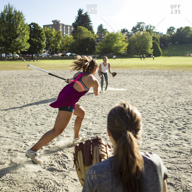 Women playing softball in a Vancouver, Canada park