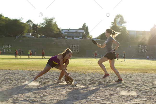 Softball game runner and infielder in Vancouver, Canada