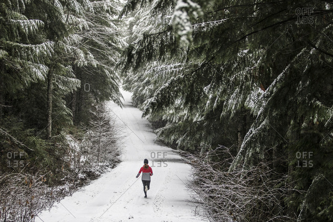 Runner on a trail in winter