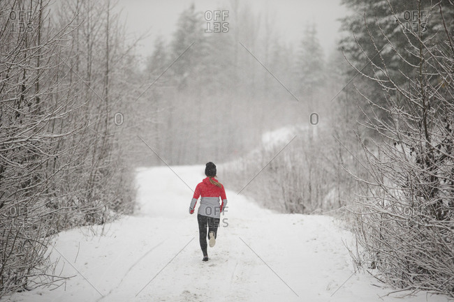 Runner in the snow on a trail