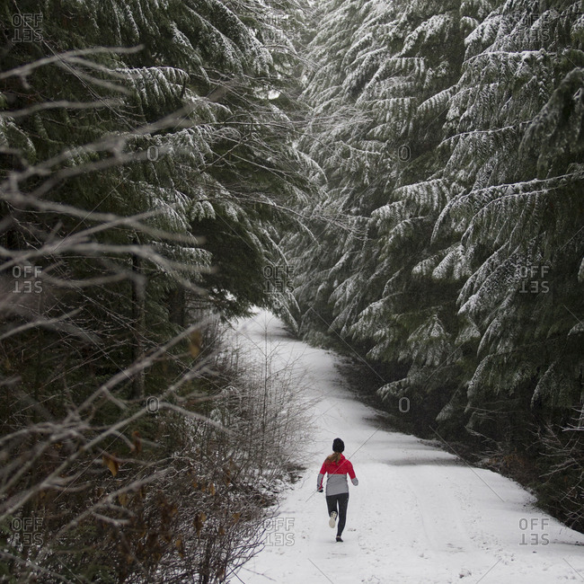Runner on a trail during winter