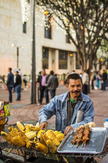 Bogota, Colombia - December 3, 2013:  Street vendor selling corn