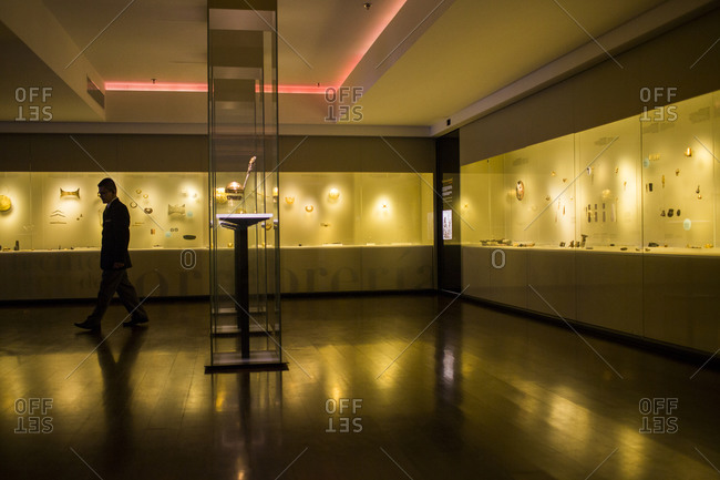 Bogota, Colombia - December 4, 2013: Security gard in gallery at the Museo de Oro