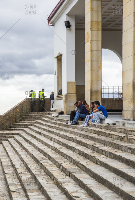 Bogota, Colombia - December 4, 2013:People sitting on a set of stairs leading to a church at the top of Mount Monserrate which overlooks downtown Bogota