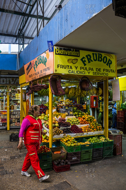 Bogota, Colombia - December 4, 2013: Woman by fruit stand in Bogota market