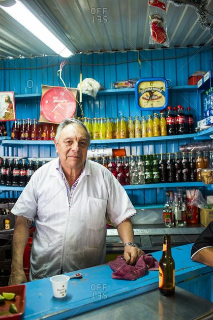 Bogota, Colombia - December 4, 2013: Drinks vendor at Bogota market