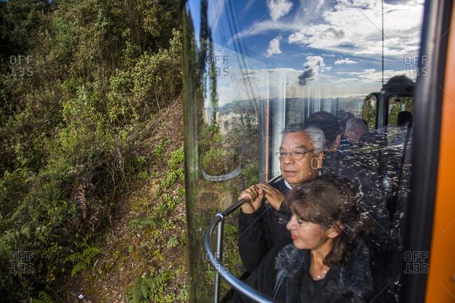 Bogota, Colombia - December 4, 2013: Visitors riding cable car in Bogota