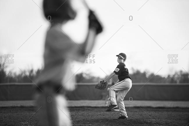 Boys playing baseball on a field