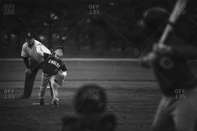 Young boy playing baseball on a field