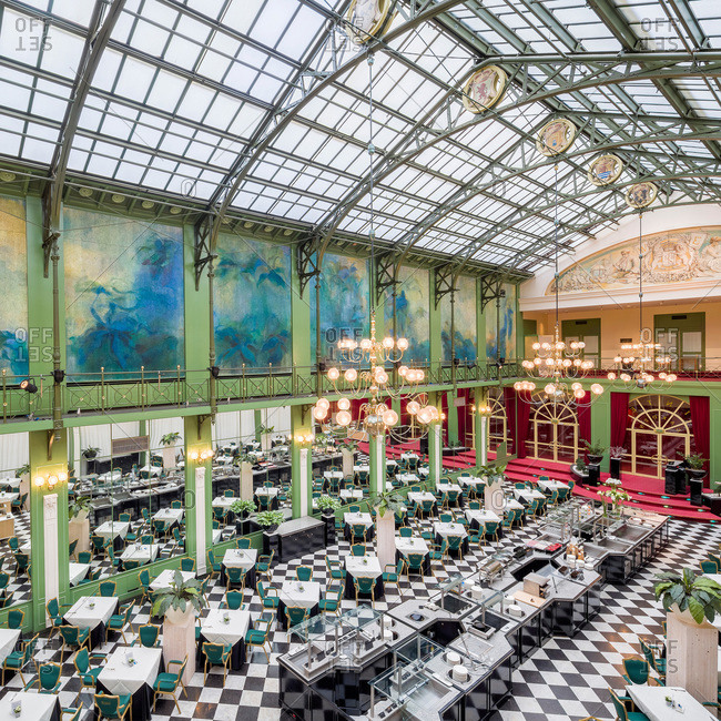 Amsterdam, Netherlands - June 19, 2015: Interior of the historical winter garden, now a dining room in the famous five star Krasnapolski hotel
