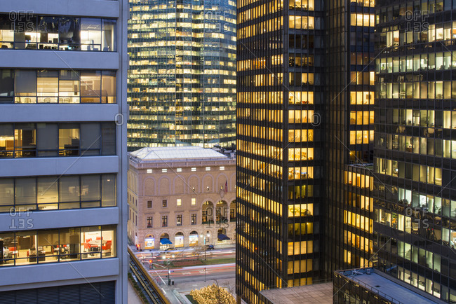 New York, NY, USA - December 12, 2014: Illuminated office buildings in New York City, USA