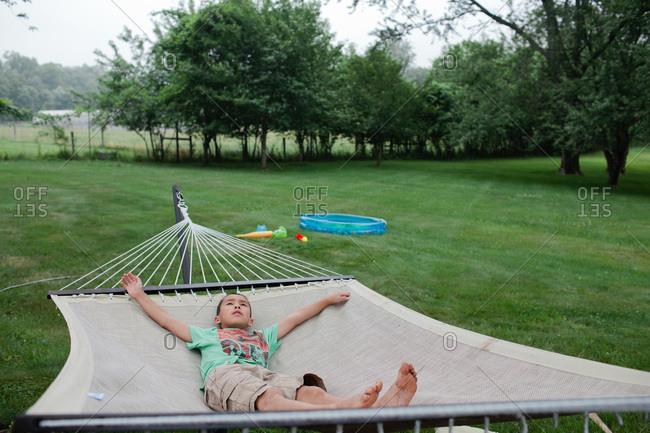 Boy lying in hammock