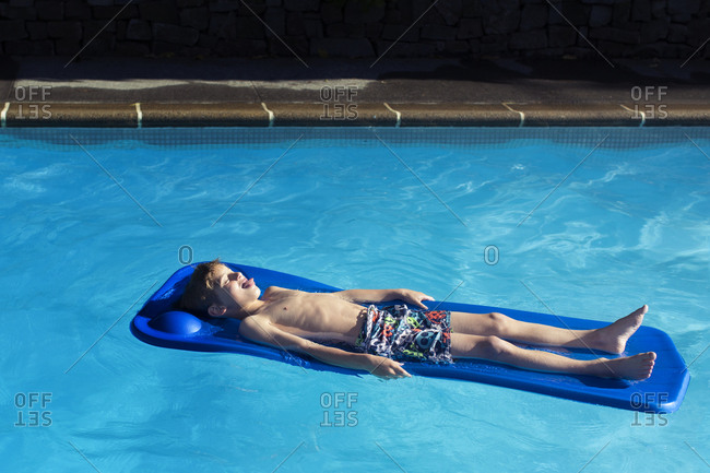 Young boy relaxing on a float