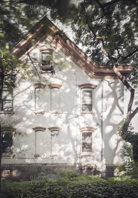 Shadows settle on a vacant historic home in Staten Island