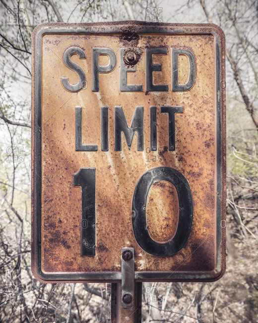 Rusty speed limit sign