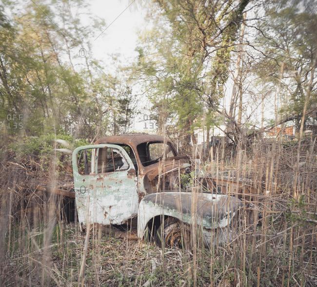 Rusty abandoned truck in a junkyard
