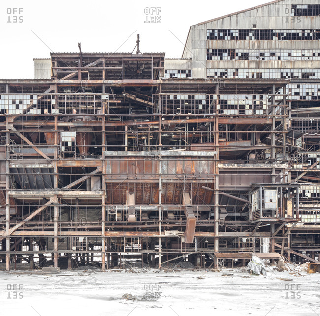 Exterior of an abandoned coal breaker mid-demolition