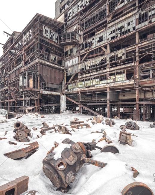 Abandoned coal breaker mid-demolition with debris