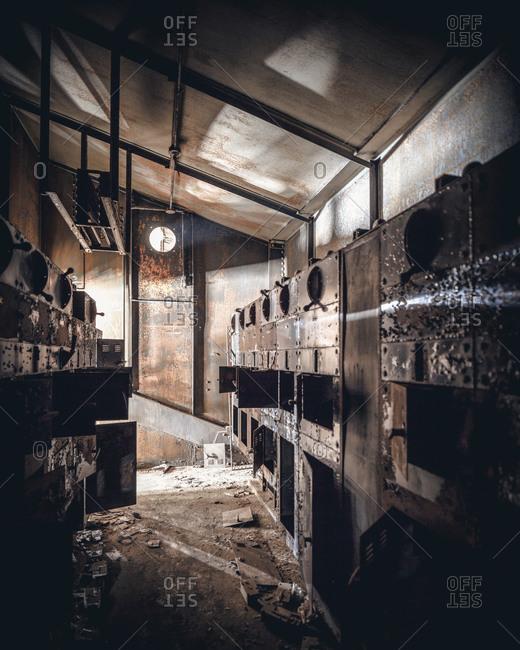 Dark control room in an abandoned coal breaker