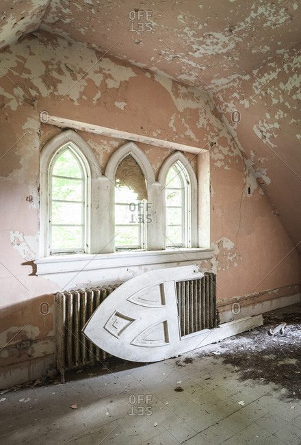 Pink interior of an abandoned manor in upstate New York