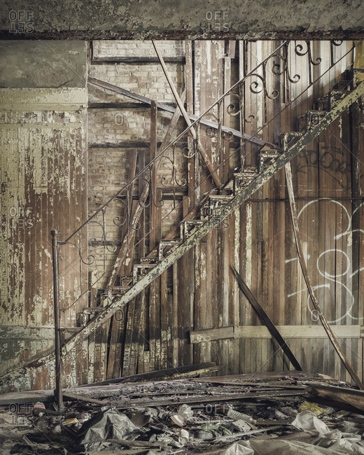 Staircase with ornate railing in an abandoned jail