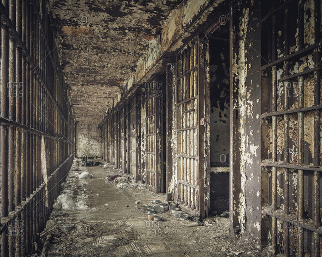 Hall of jail cells in an abandoned prison
